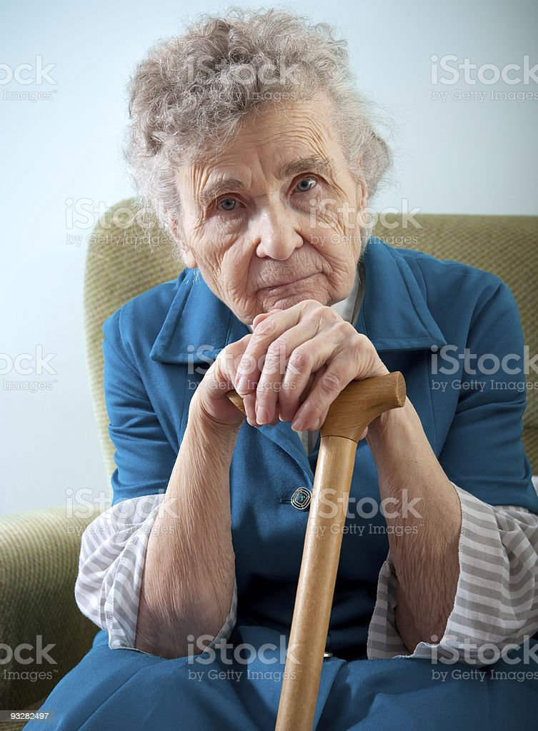 elderly woman at home stock photo