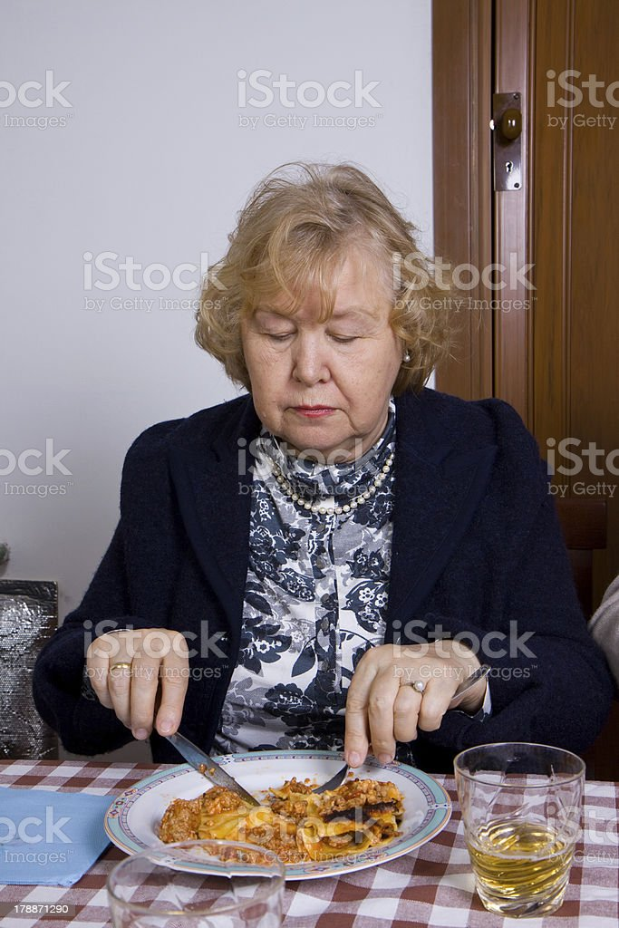 elderly woman at table royalty-free stock photo