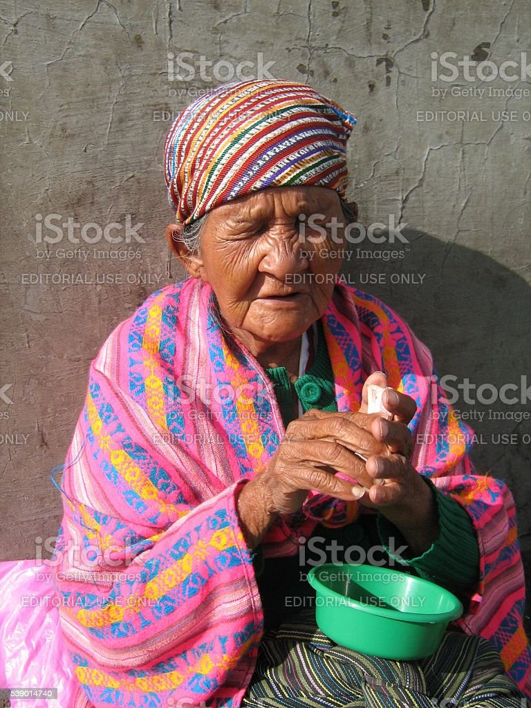 Elderly Woman Begging in Central America stock photo