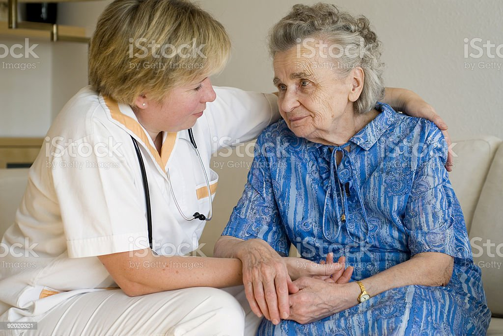Elderly woman being cared for by a doctor royalty-free stock photo