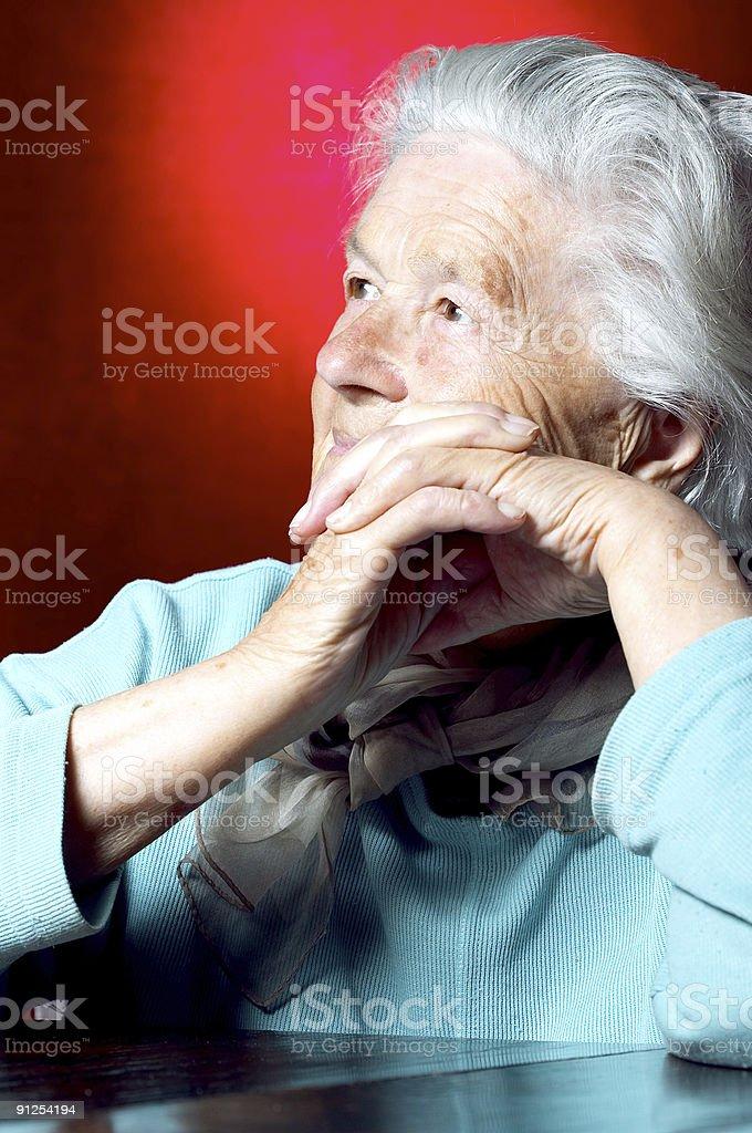 Elderly woman contemplating royalty-free stock photo