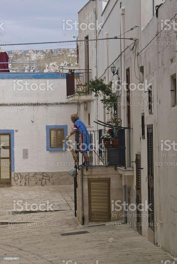 Elderly woman doing housework. royalty-free stock photo