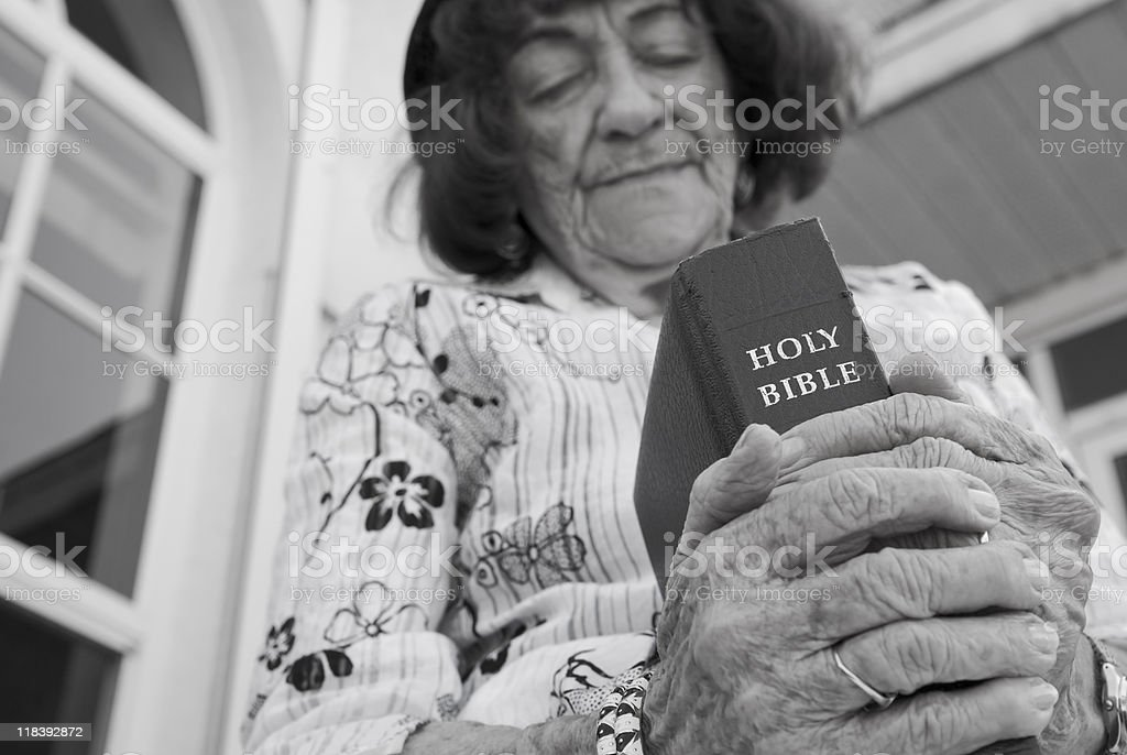 Grandmother and her Bible stock photo