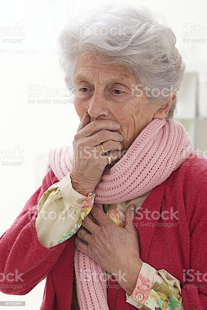 elderly woman feeling unwell stock photo