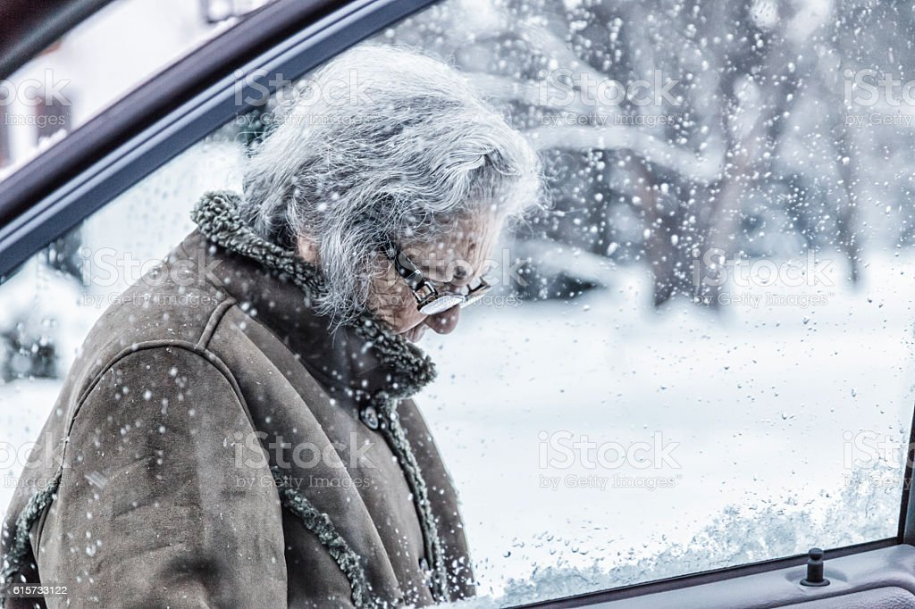 Elderly Woman Going Out For Winter Shopping Car Errands stock photo