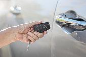 Elderly woman hand on key car alarm systems