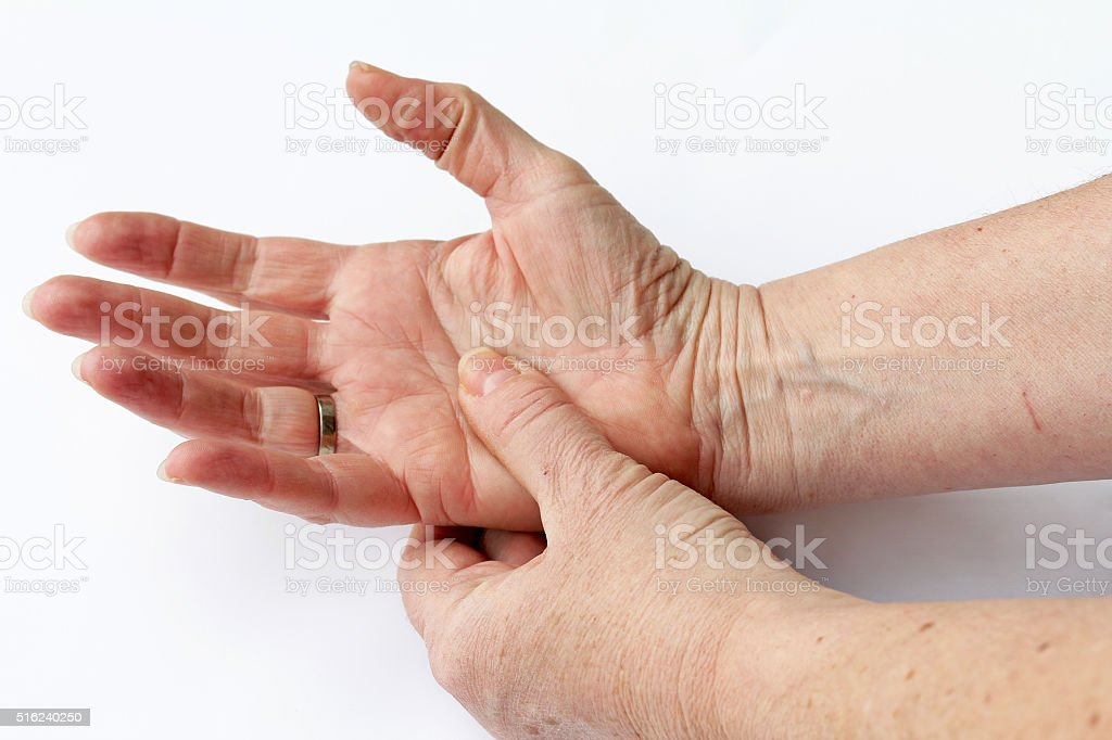 elderly woman has pain in his hands stock photo
