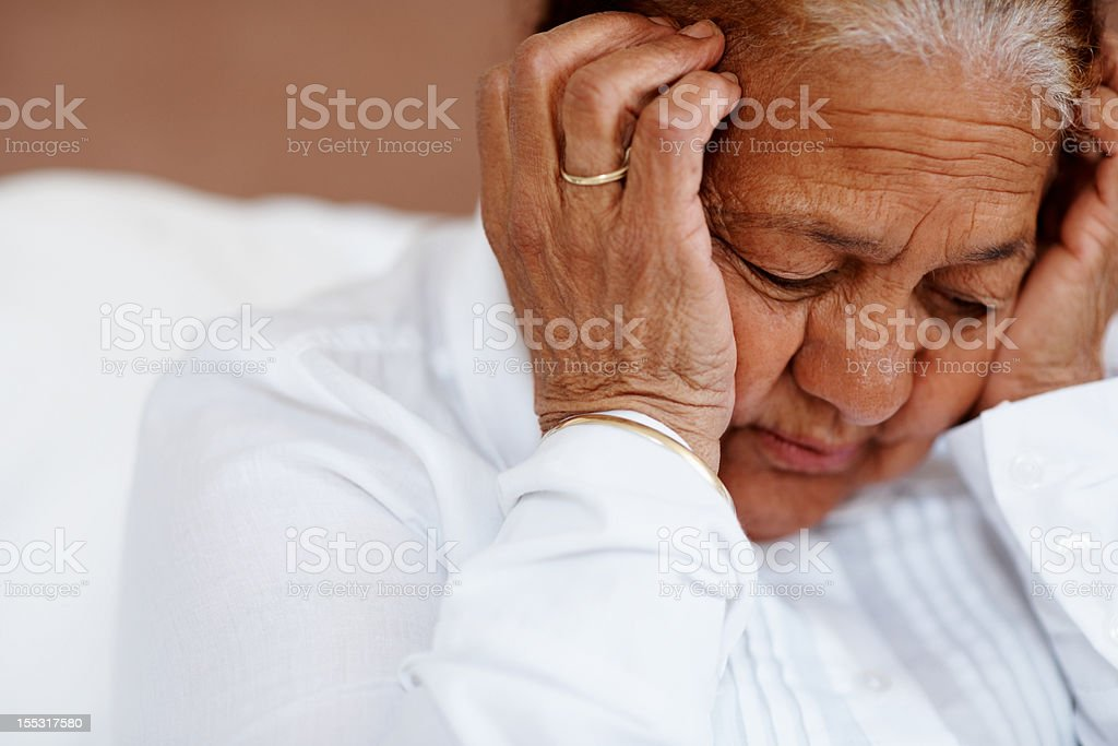 Elderly woman having a headache royalty-free stock photo