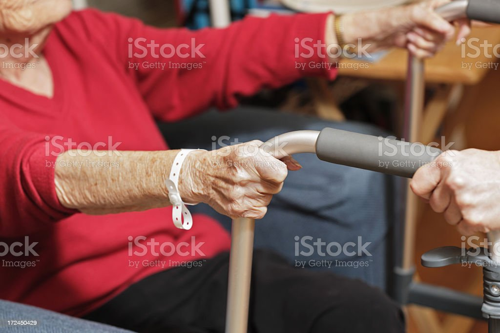 Elderly Woman Helped With Walker royalty-free stock photo