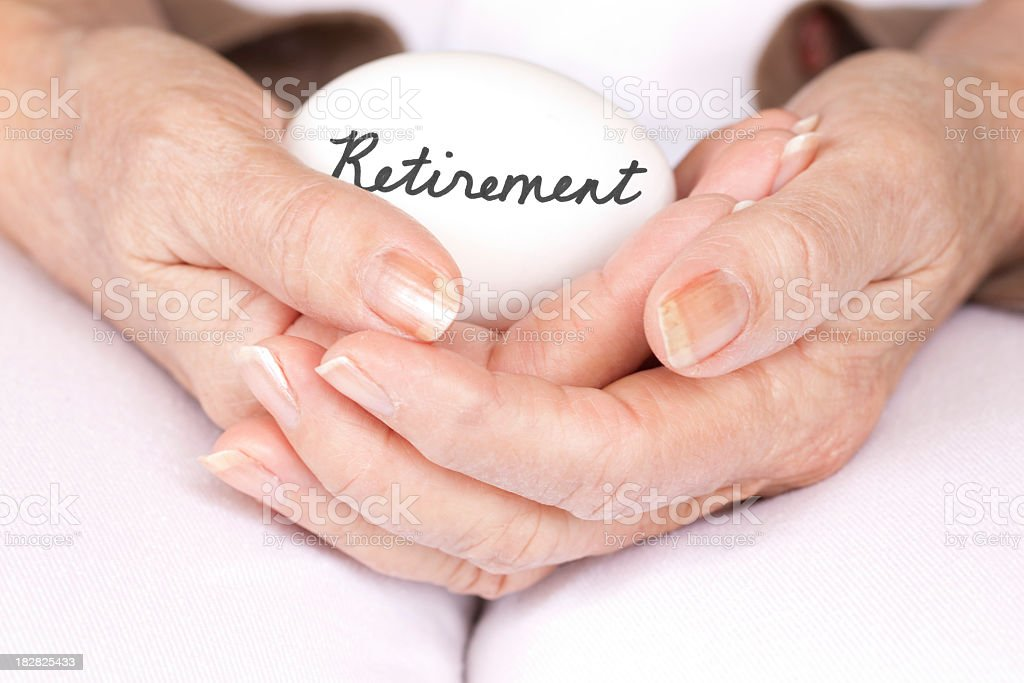 Elderly woman holding retirement egg royalty-free stock photo