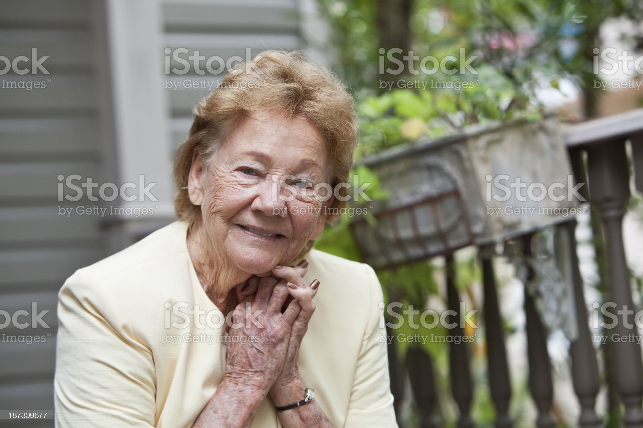 Elderly woman in front of home royalty-free stock photo
