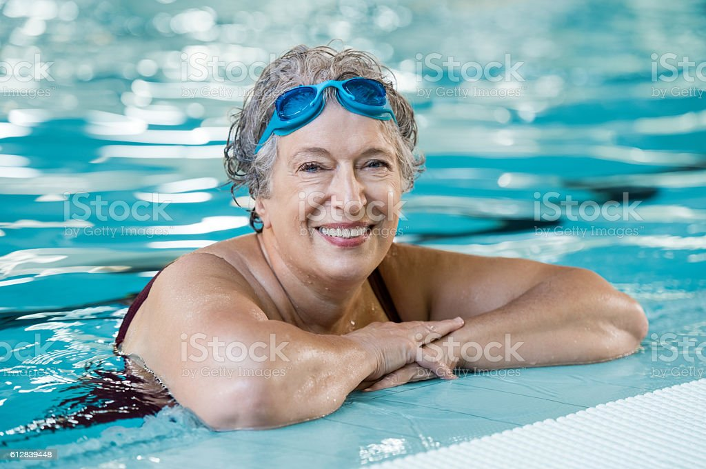 Elderly woman in pool stock photo