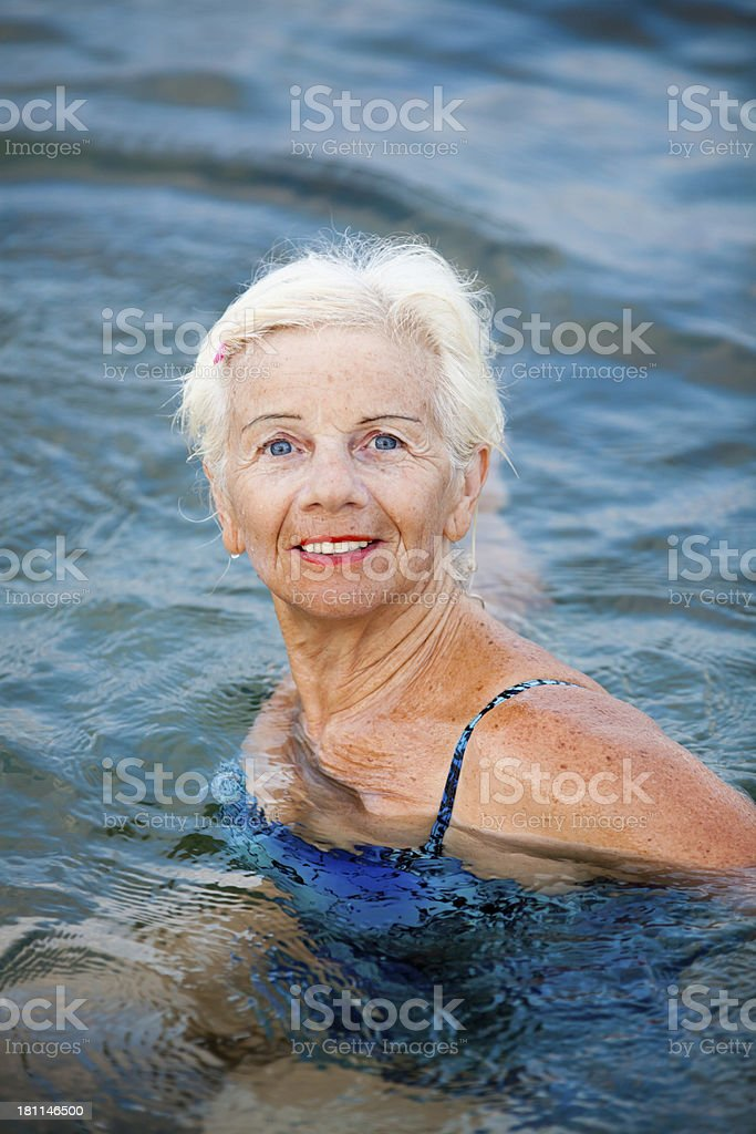 Elderly woman in the sea royalty-free stock photo