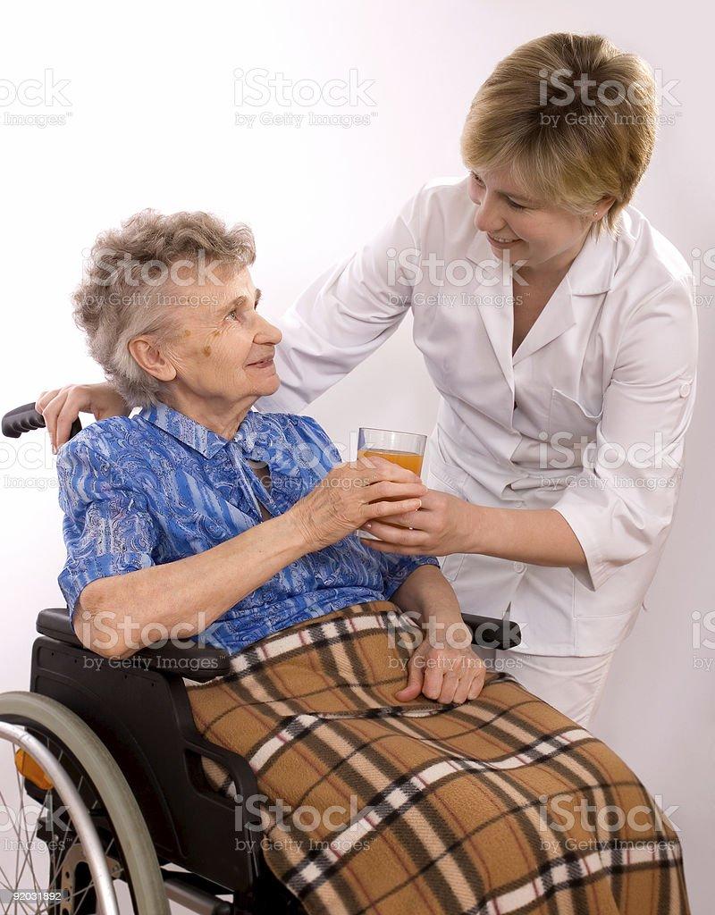 elderly woman in wheelchair royalty-free stock photo