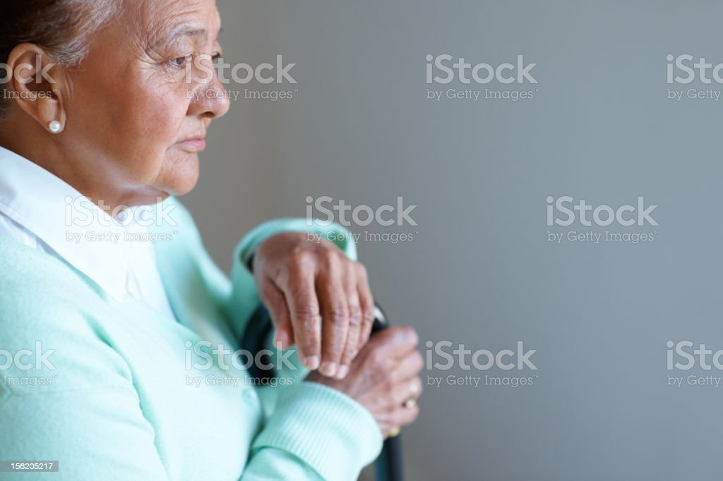 Elderly woman looking away in a pensive mood royalty-free stock photo