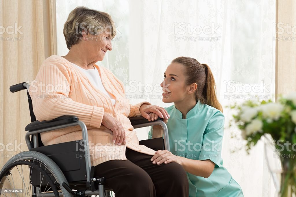 Elderly woman on wheelchair stock photo