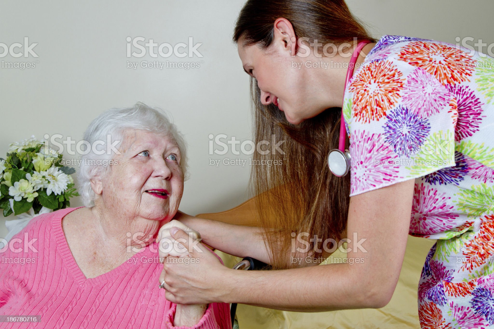 Elderly Woman on wheelchair with a nurse royalty-free stock photo