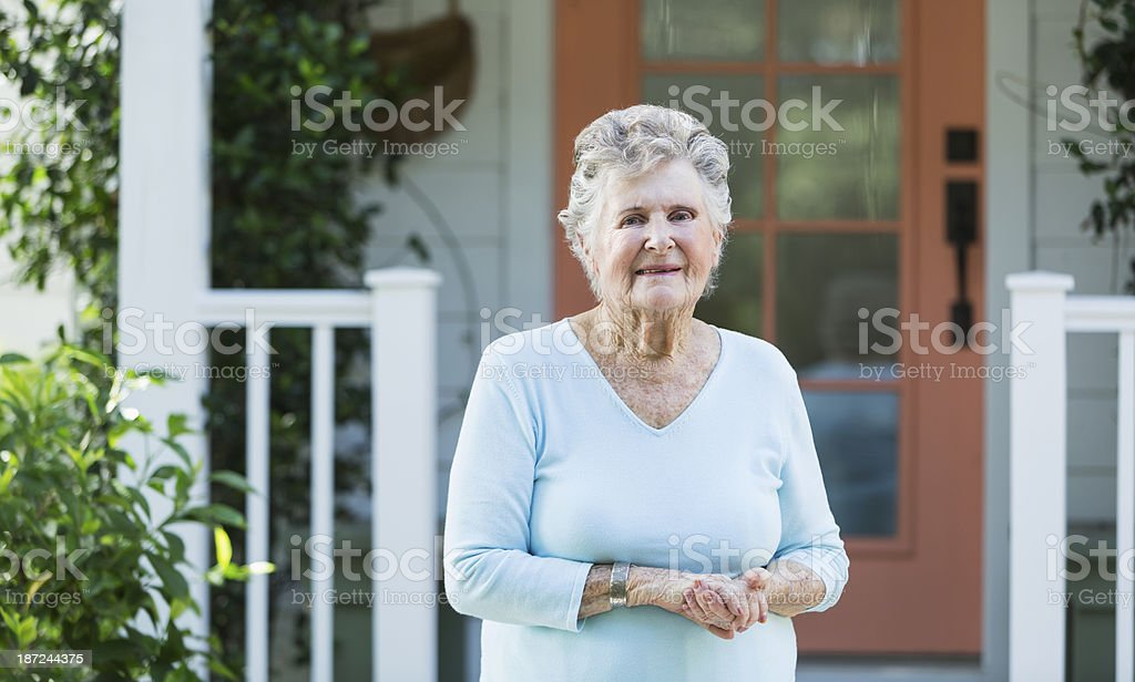 Elderly woman outside home royalty-free stock photo