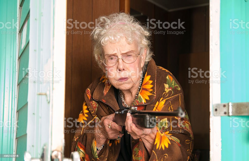 Elderly woman protecting her trailor stock photo