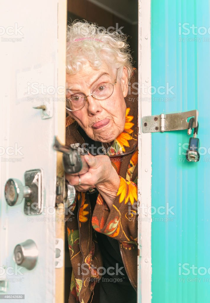 Elderly woman protecting her trailor with a BB gun stock photo
