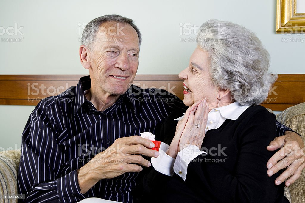 Elderly Woman Receiving a Gift royalty-free stock photo