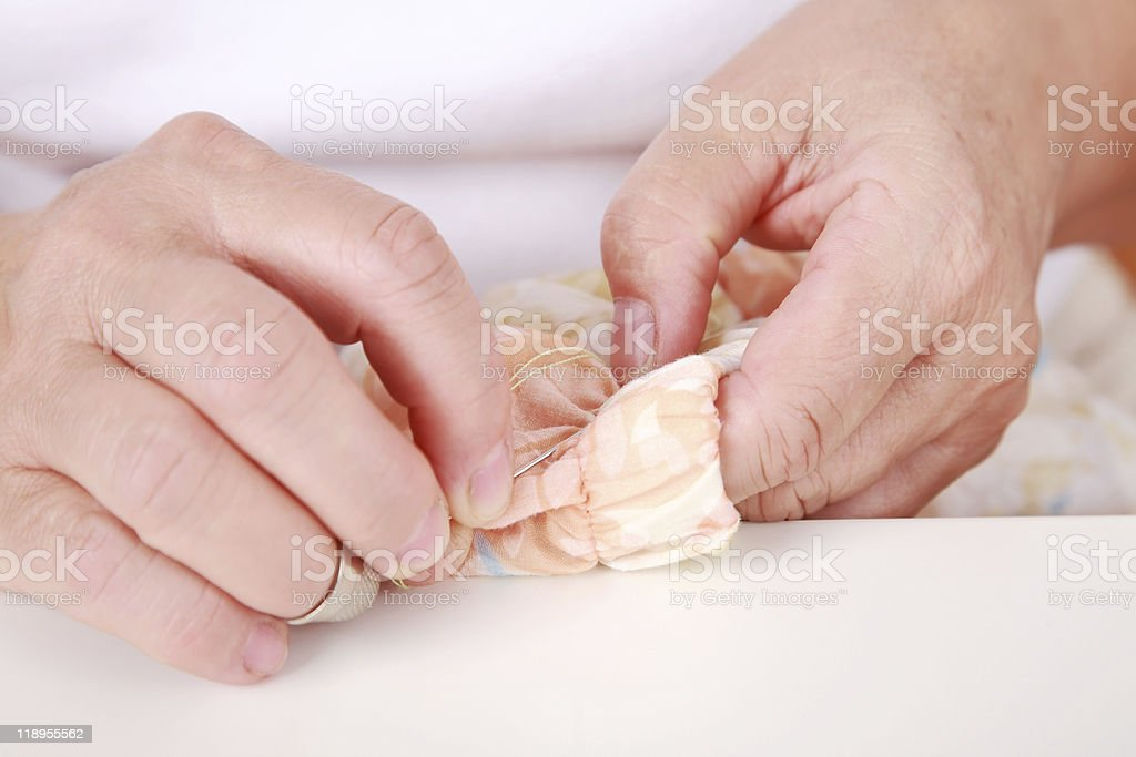 Elderly woman sewing royalty-free stock photo