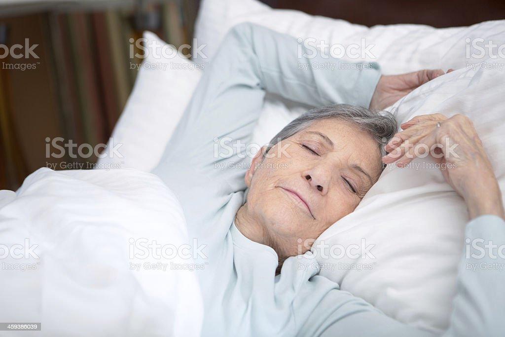 Elderly woman sleeping royalty-free stock photo