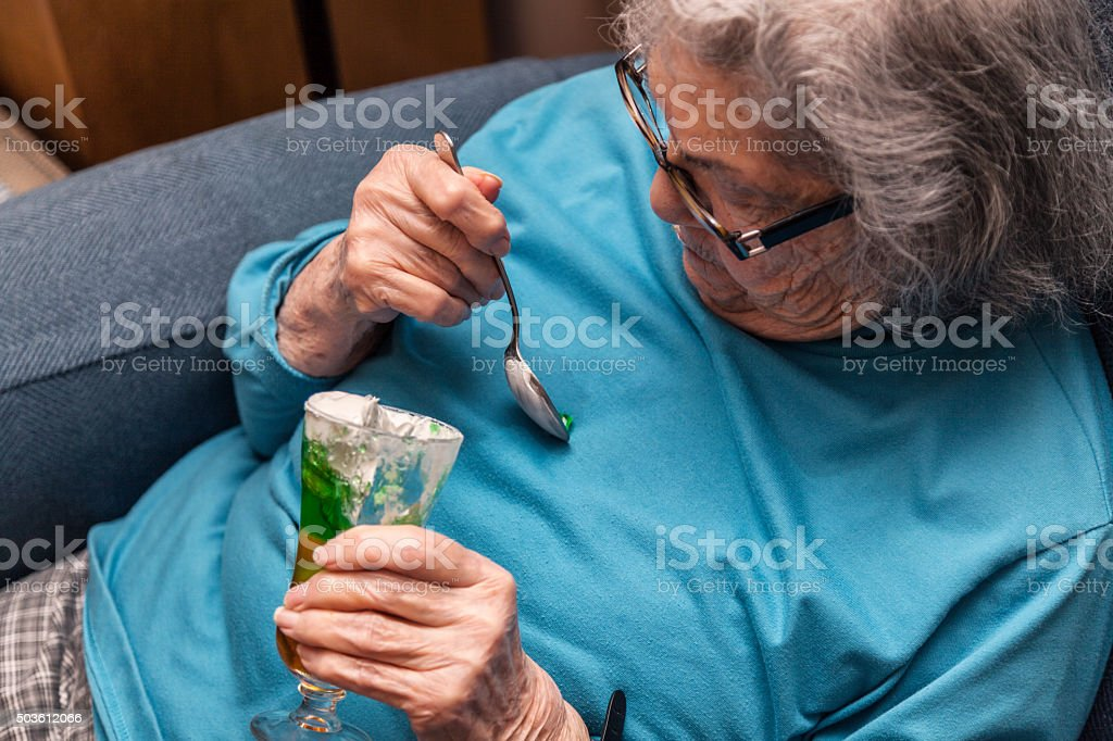Elderly Woman Spilling Parfait Whipped Cream Gelatin Dessert stock photo