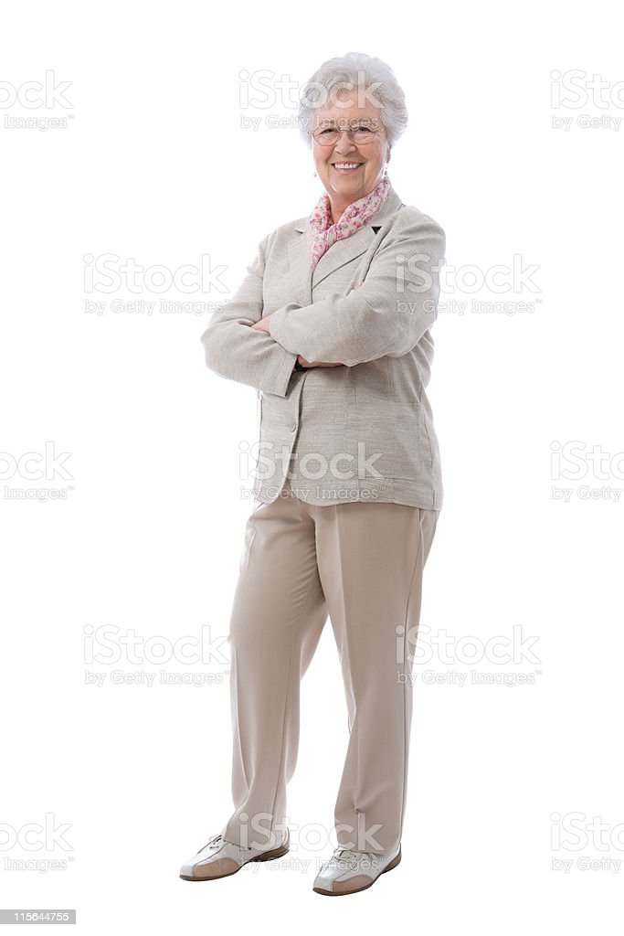 Elderly woman standing with arms crossed royalty-free stock photo