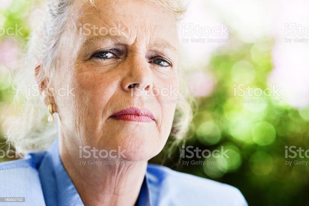 Elderly woman staring seriously and suspiciously royalty-free stock photo
