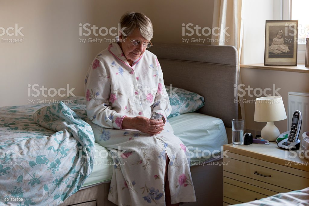 Elderly Woman Taking Medication stock photo