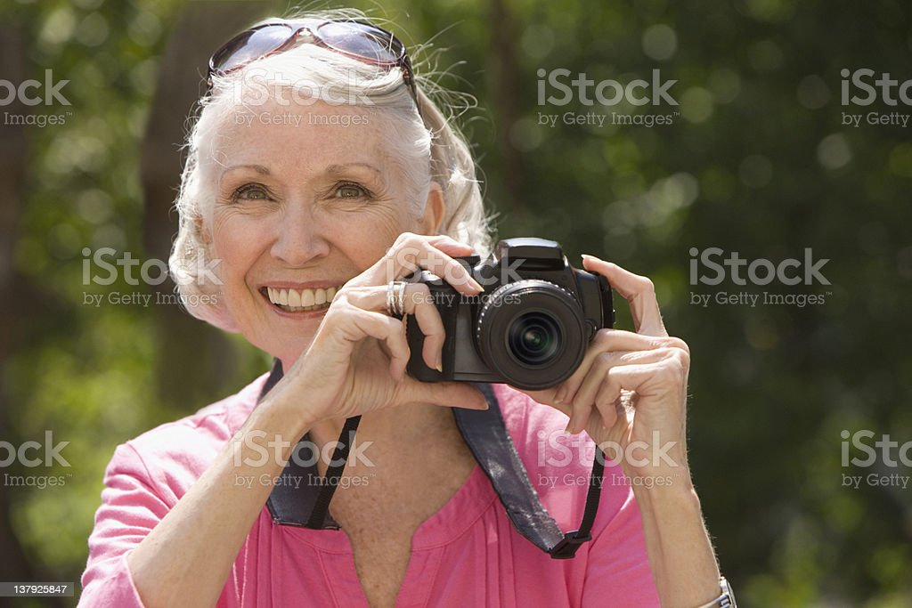 Elderly woman taking  picture royalty-free stock photo