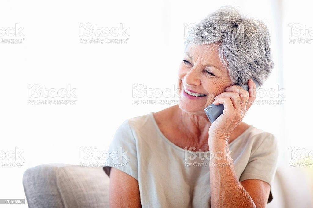 Elderly woman talking on phone royalty-free stock photo