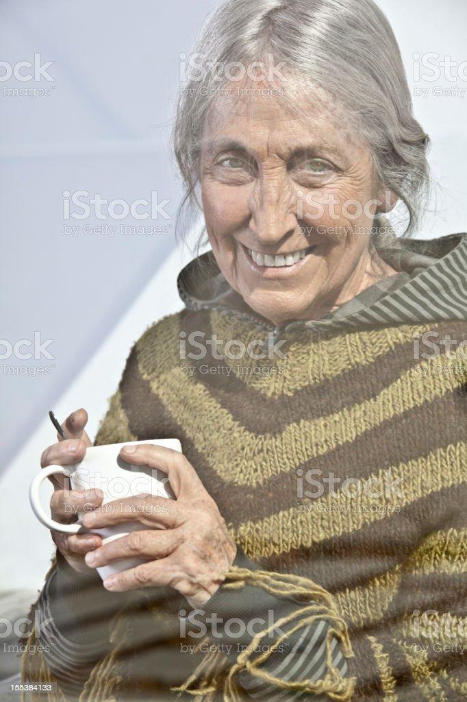 Elderly woman through window royalty-free stock photo