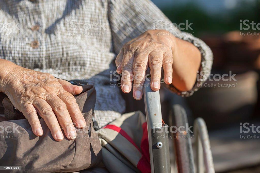 Elderly woman travel with wheelchair stock photo