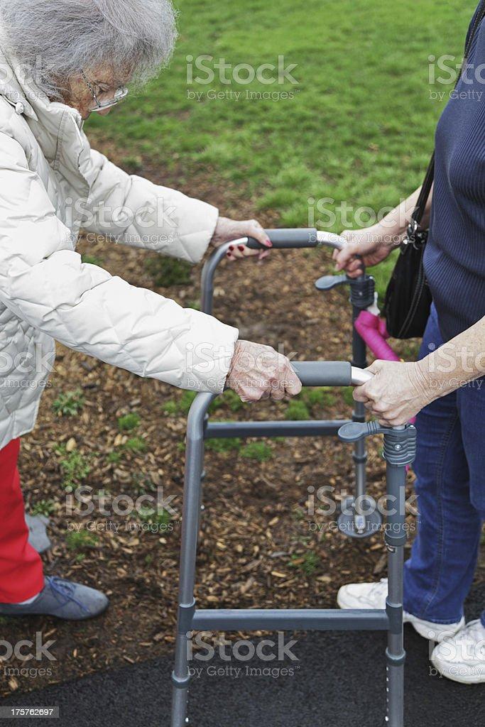 Elderly Woman Using Orthopedic Walker royalty-free stock photo