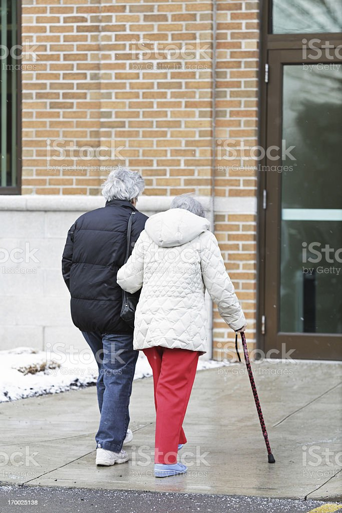 Elderly Woman Walking With Cane royalty-free stock photo