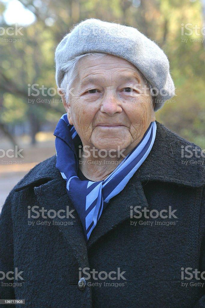Elderly woman wearing a coat. royalty-free stock photo