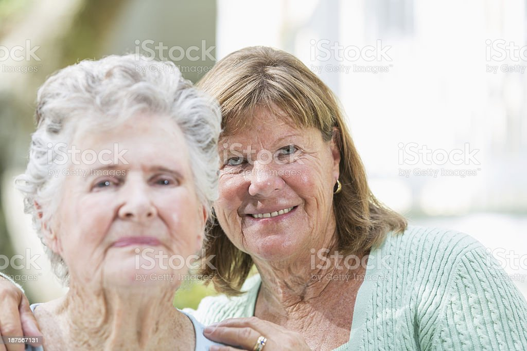 Elderly woman with adult daughter royalty-free stock photo