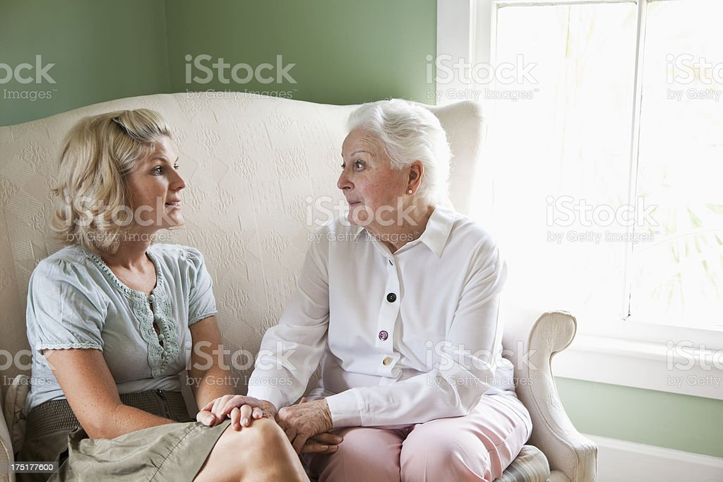 Elderly woman with adult granddaughter stock photo