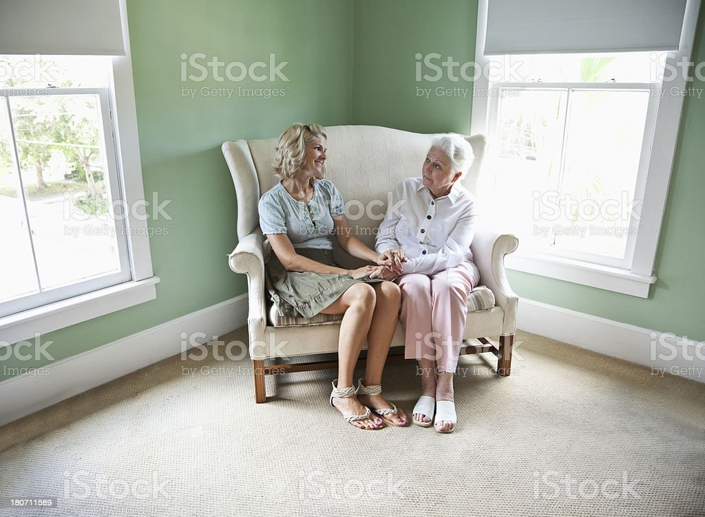 Elderly woman with adult granddaughter royalty-free stock photo