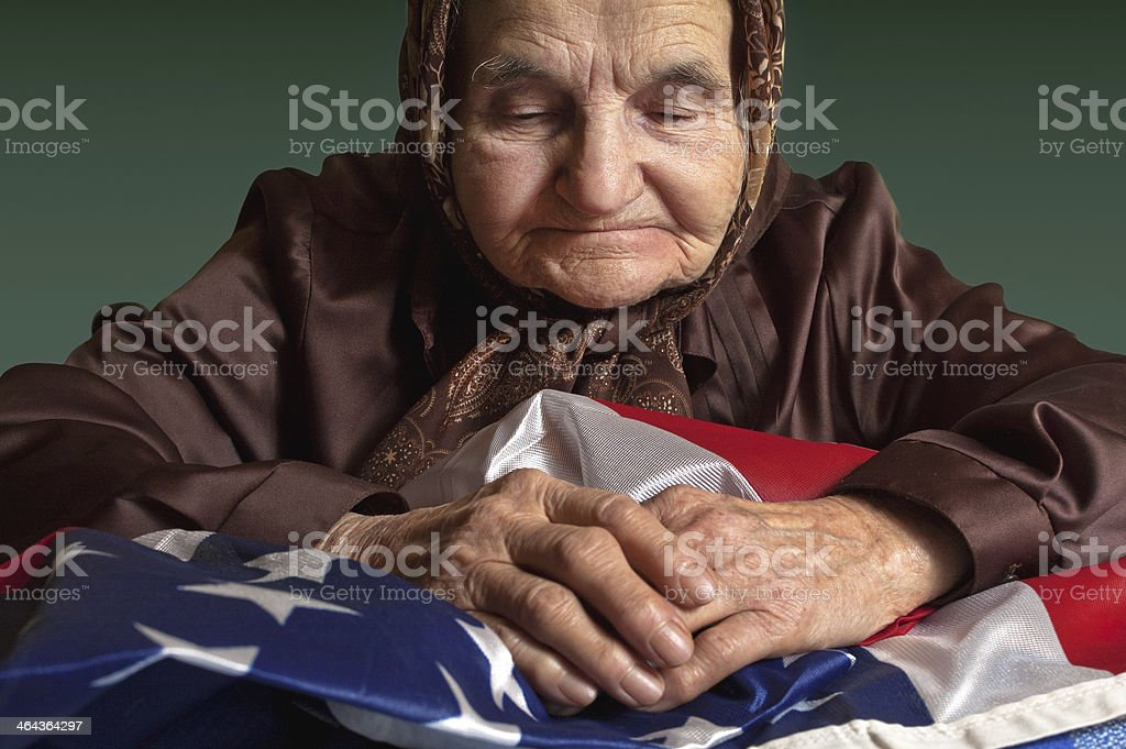 Elderly woman with American flag stock photo