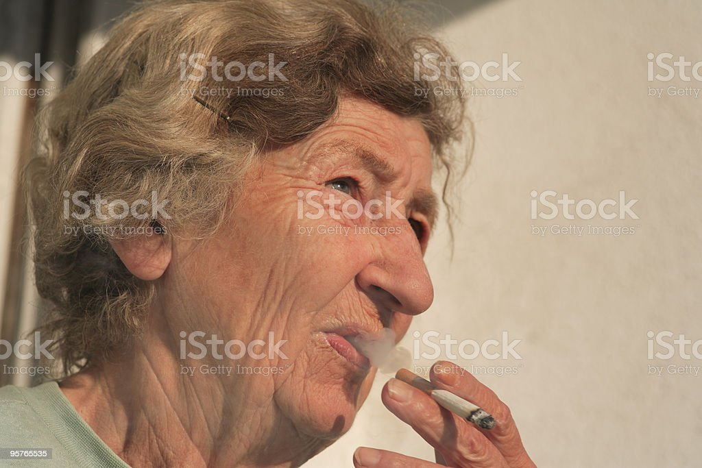 Elderly Woman with Cigarette royalty-free stock photo