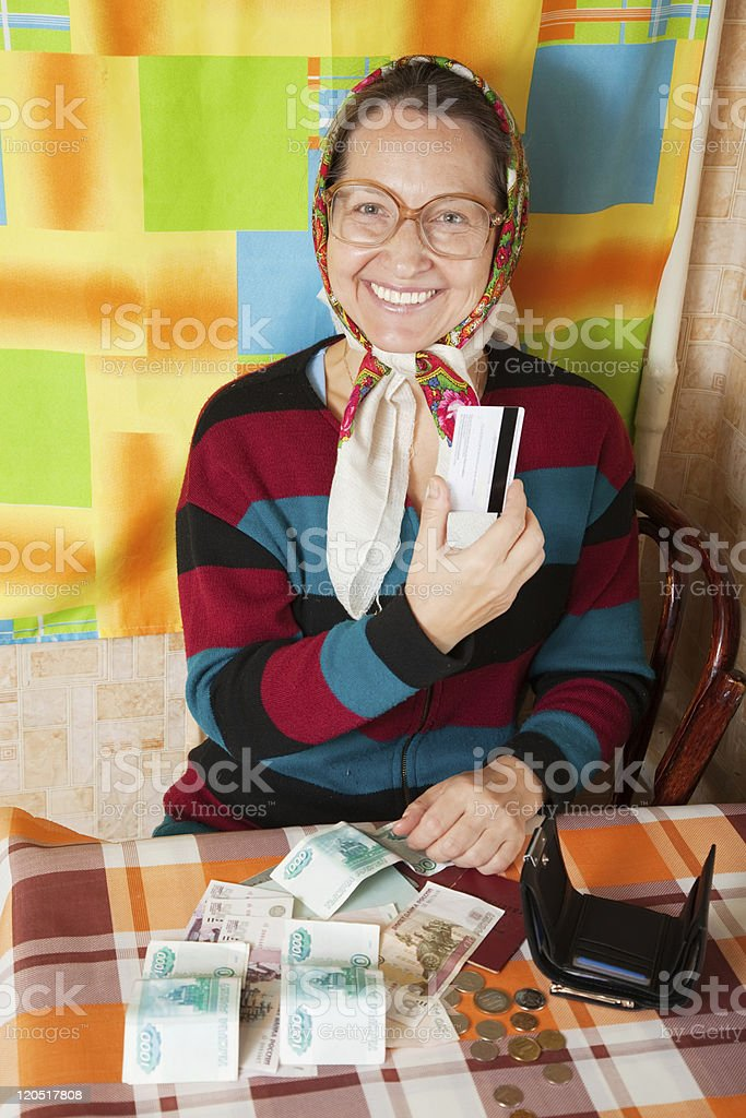 elderly woman with  credit card stock photo