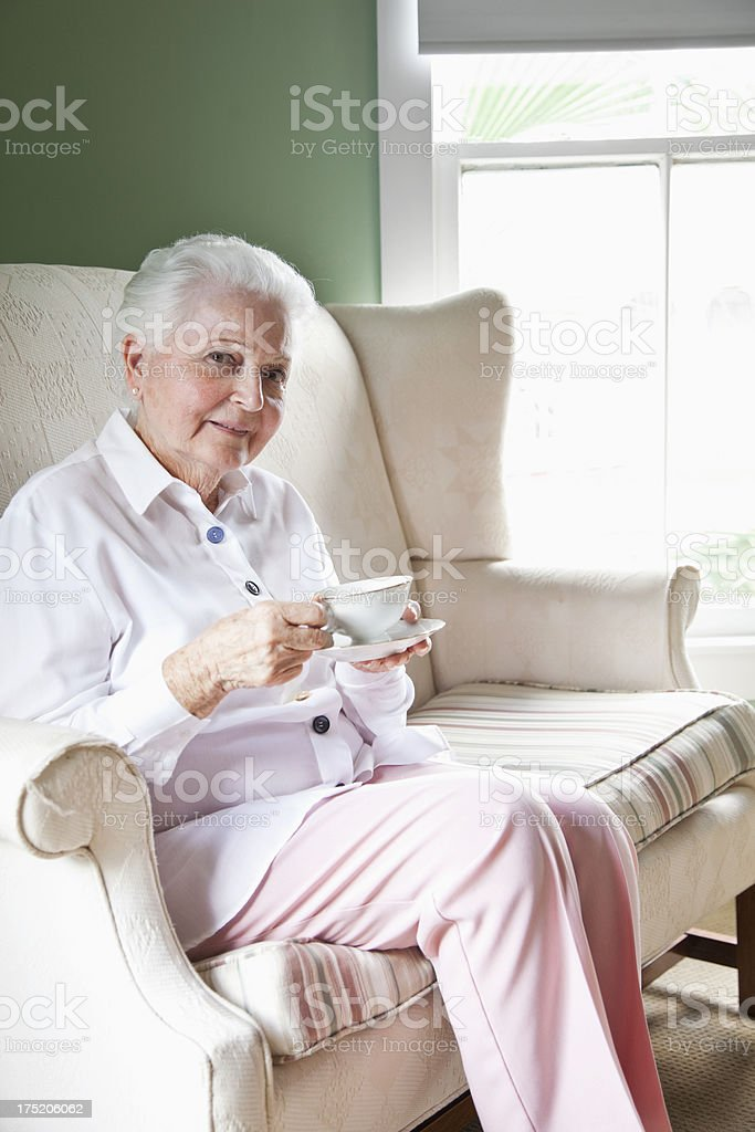 Elderly woman with cup of tea royalty-free stock photo