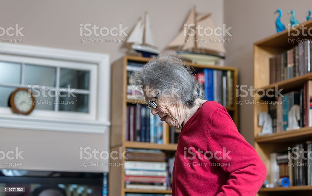 Elderly Woman With Dementia Walking Carefully At Home stock photo