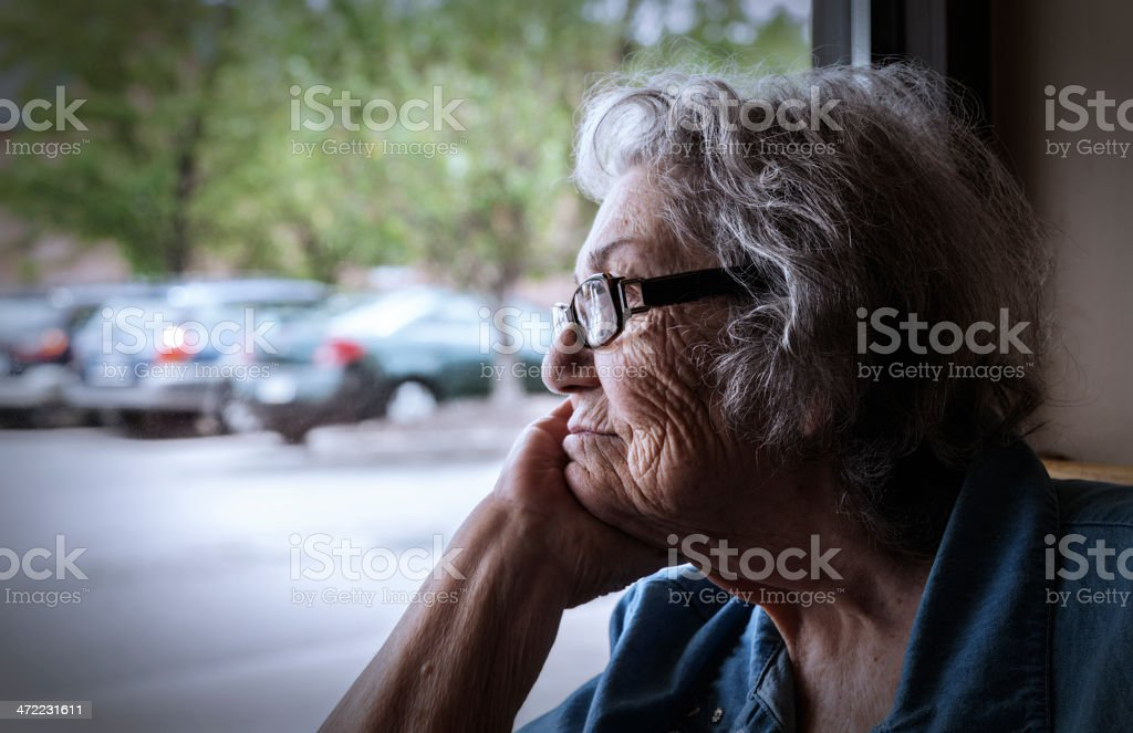 An elderly senior woman Grandma with early stage dementia and a...