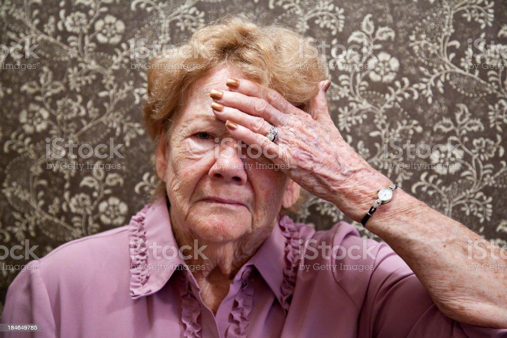 Elderly woman with headache stock photo