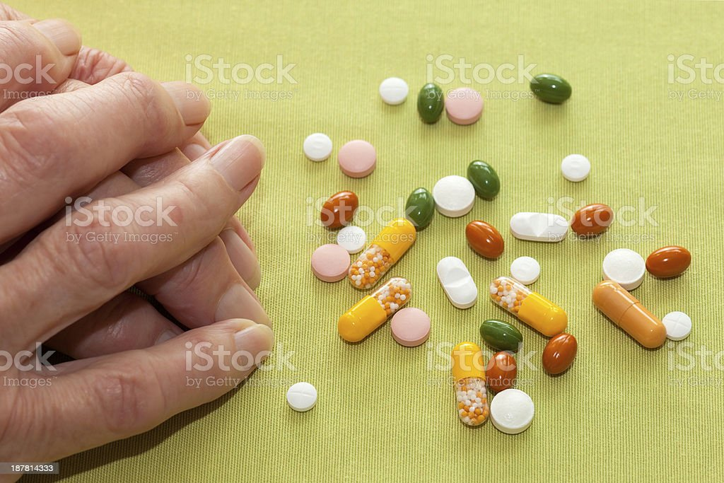 Elderly woman with her medication. royalty-free stock photo