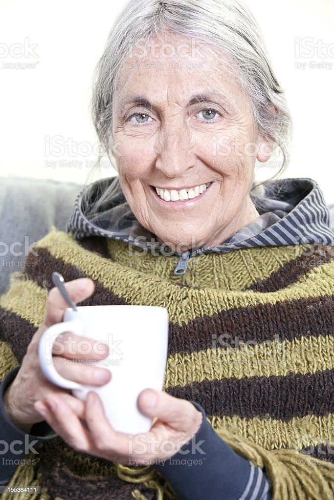 Elderly woman with hot drink royalty-free stock photo
